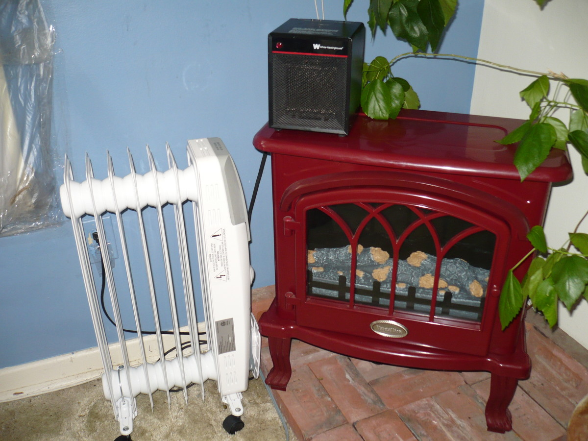 From left to right the heaters are Garrison oil filled Heater, White Westinghouse Fan Heater( is the little black heater on top), and the Vermillion Electric Fireplace Stove/heater.