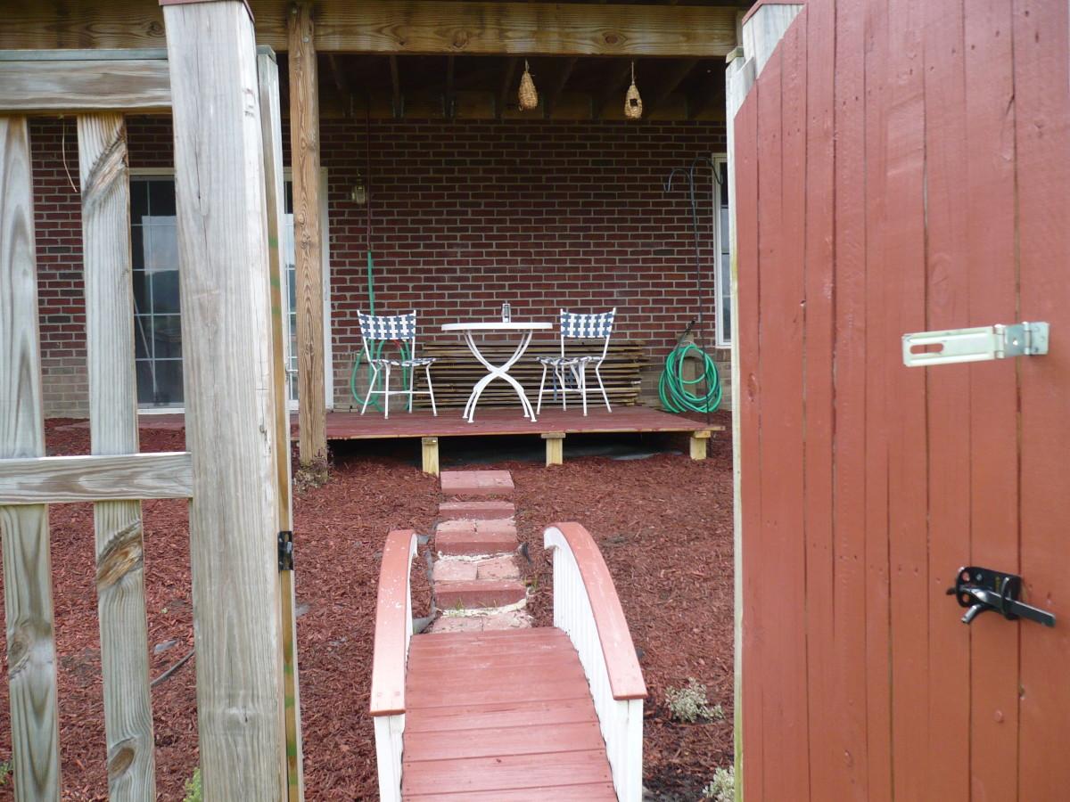 Affordable DIY maintanance free backyard makeover.