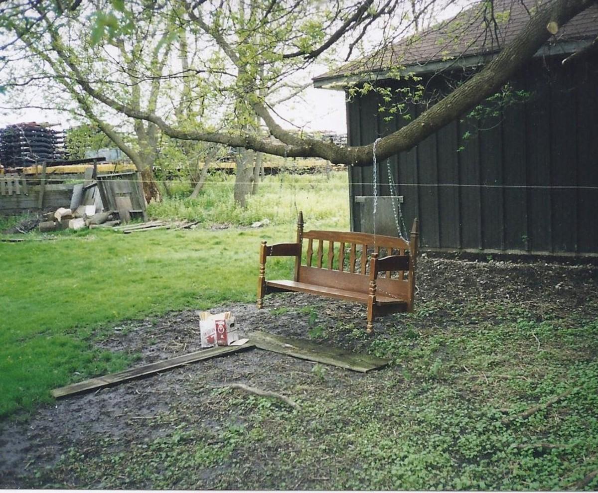 Backyard swing built from a single bed head board and foot board,