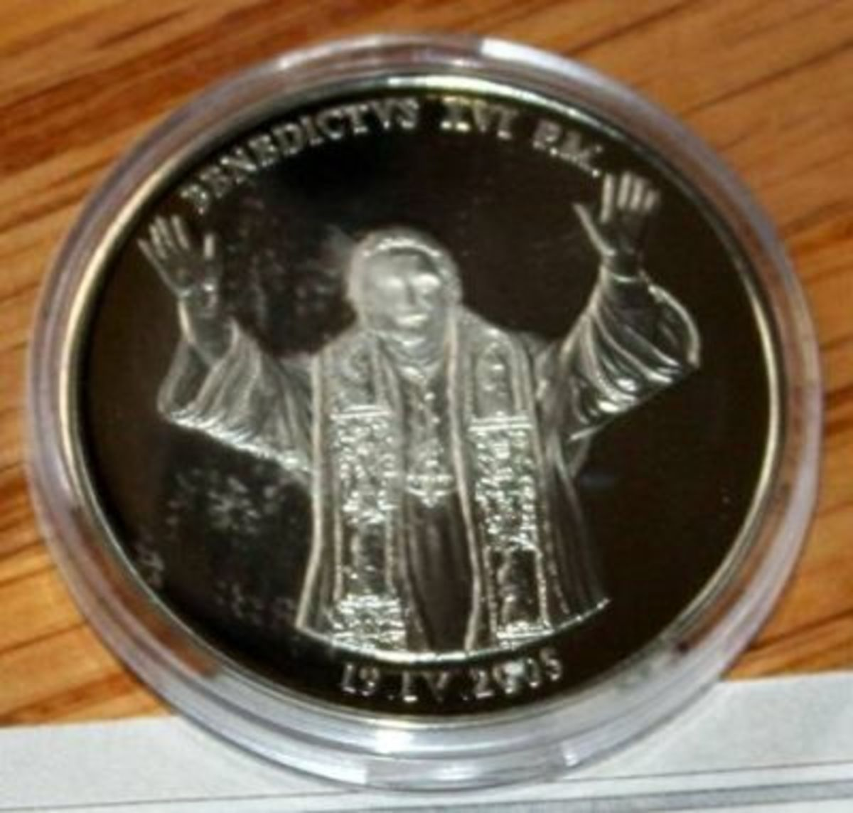 Here is a minted silver coin of Pope Benedict XVI