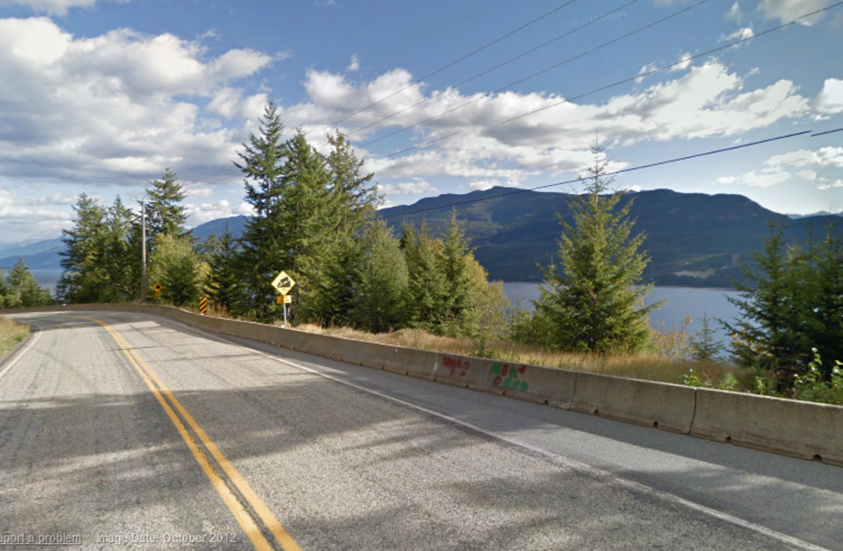 Photo: Traveling north along highway 31. Locals are familiar with the curve ahead which descends to a bridge.