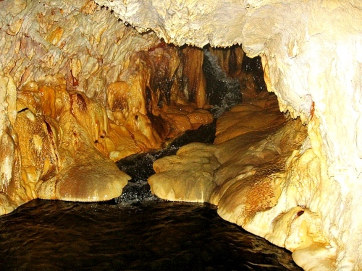 At the  back of the cave, visitors can sit where extremely hot water runs into the cave.