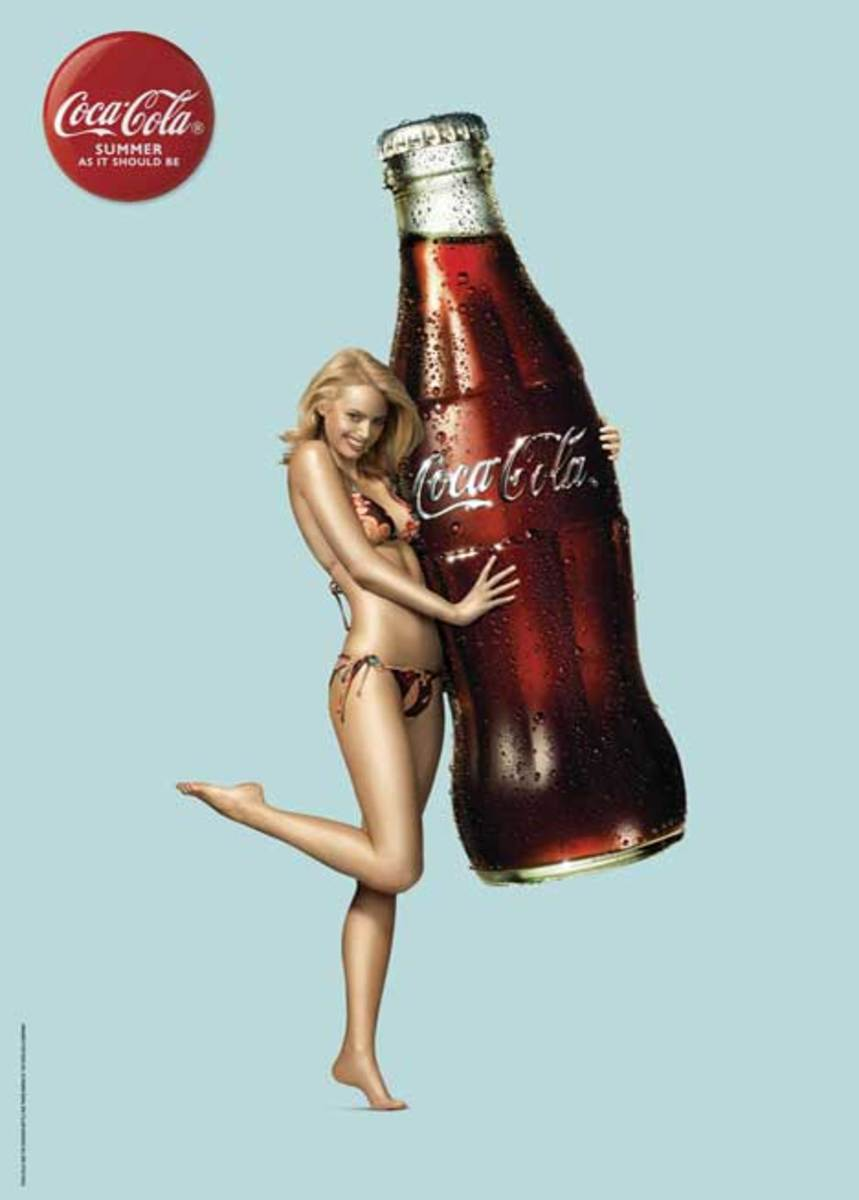 super large Coca Cola bottle and sultry girl scantily clad in a bikini