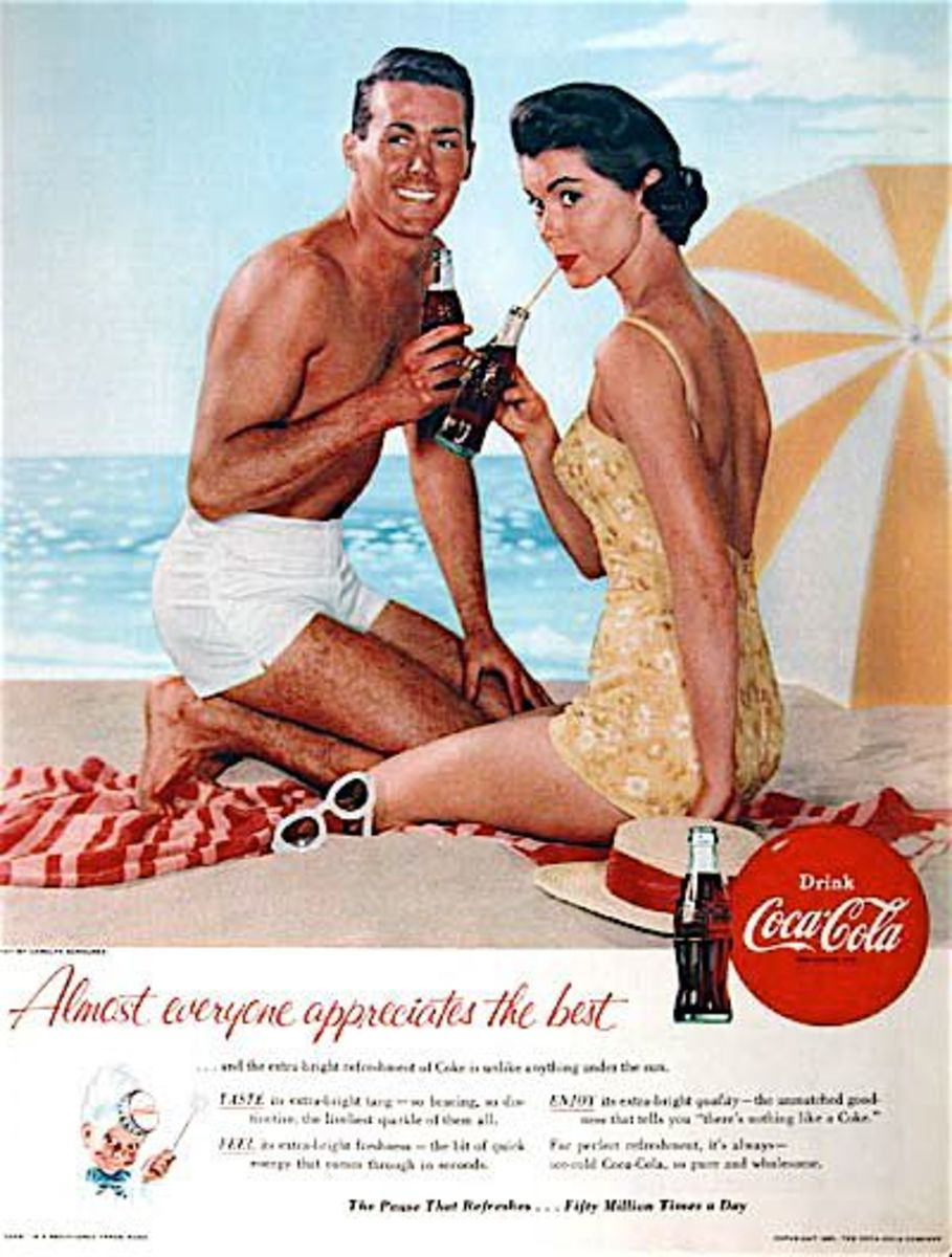 boy and girl on a beach both sipping a Coca Cola via straws with a striped yellow beach umbrella