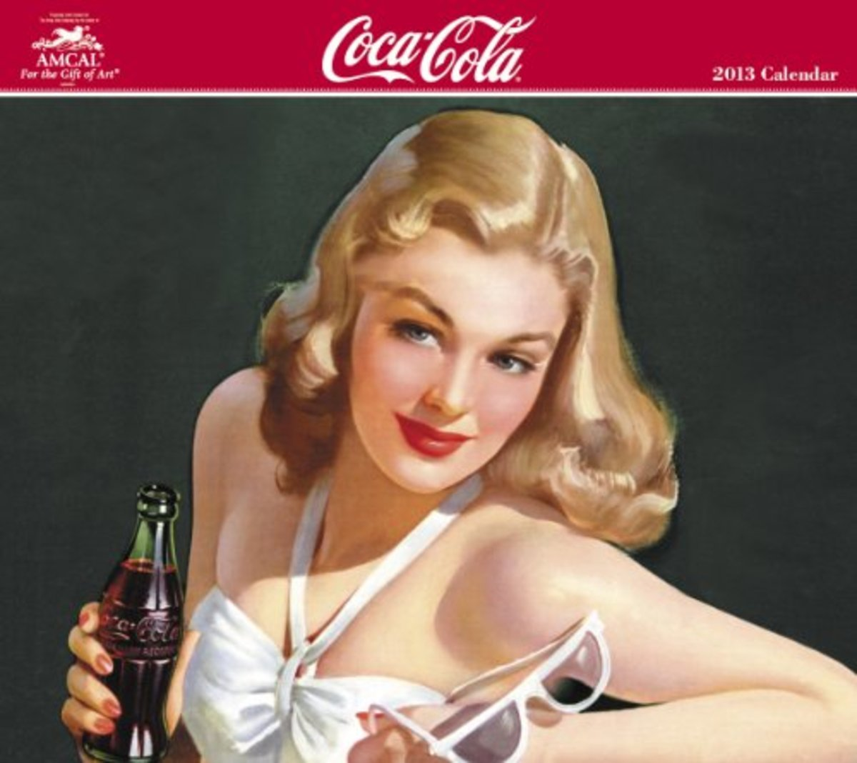 2013 Coca Cola Calendar featuring a young blond girl in a white swim suit holding white sunglasses and a Coca Cola