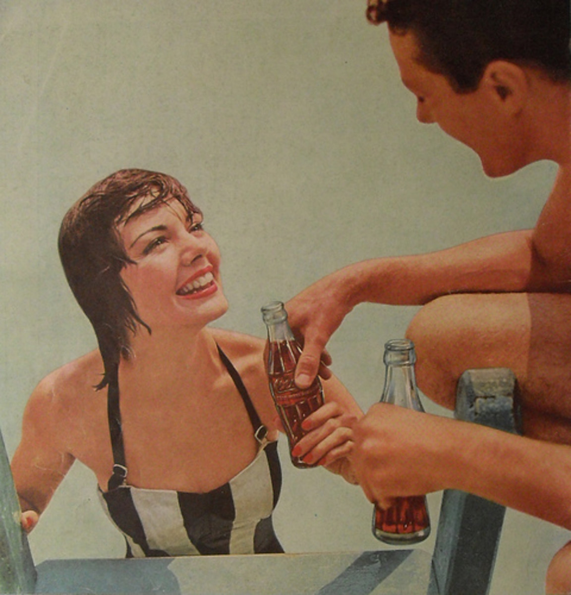 brunette boy and girl in swim suits with Coca Cola