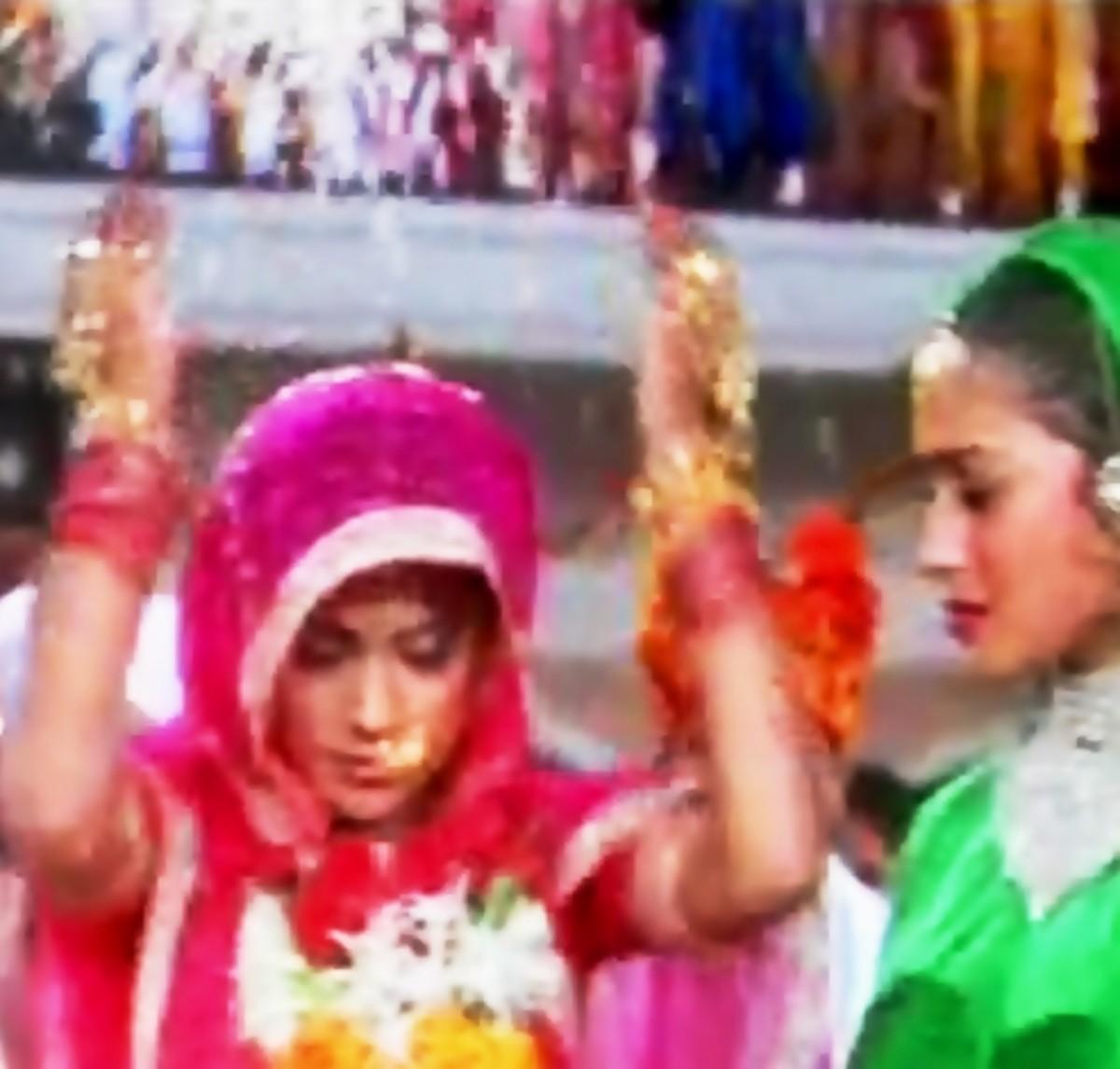 Madhuri Dixit and Renuka Sahane in Hum Aapke Hain Koun.  A great bidai song denoting wedding traditions of India.