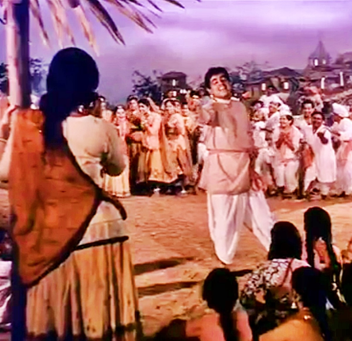 Dilip Kumar and Vaijayanthimala in Ganga Jamuna.  A beautiful folk dance celebrating love with joy.