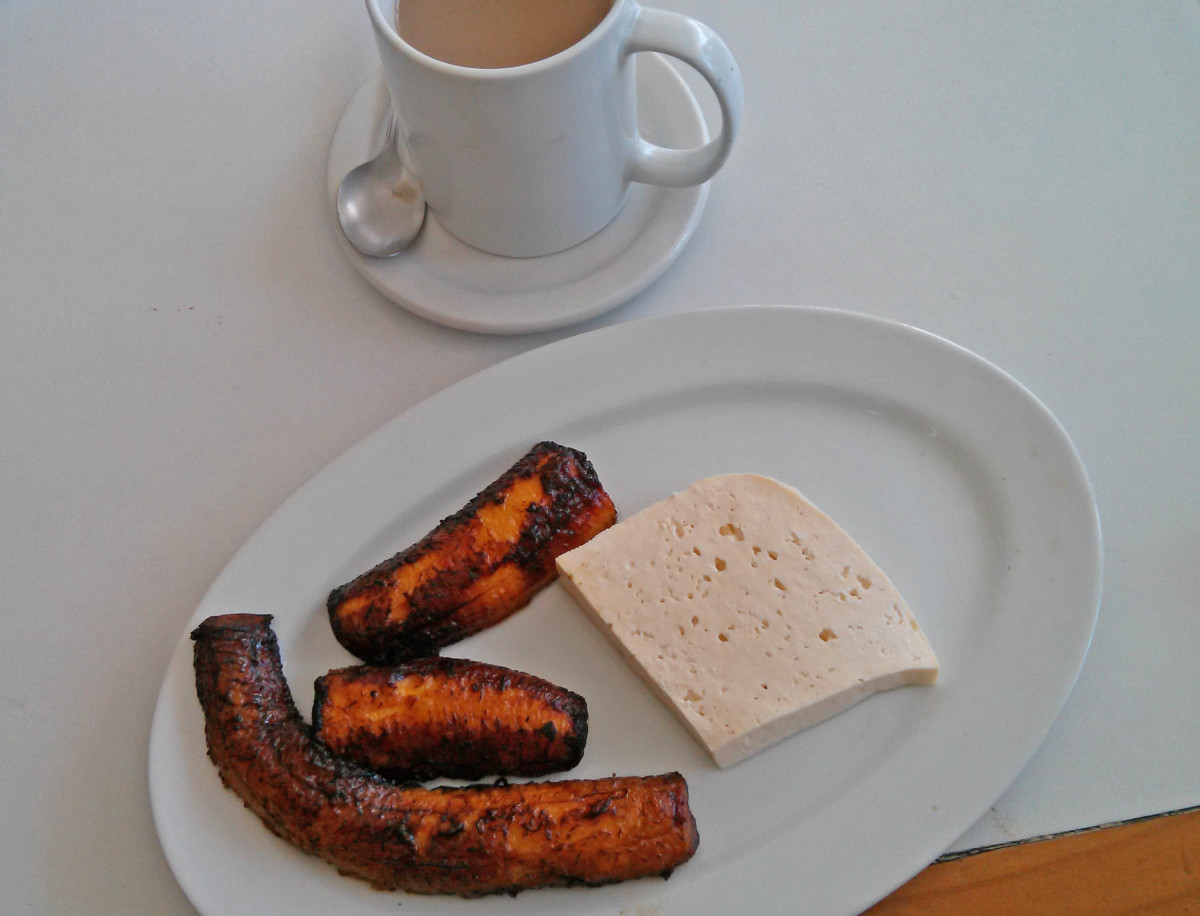 For a quick pick-me-up and snack, have a cup of coffee with cooked mature plantain and fresh white cheese.  All three flavors complement each other quite well.