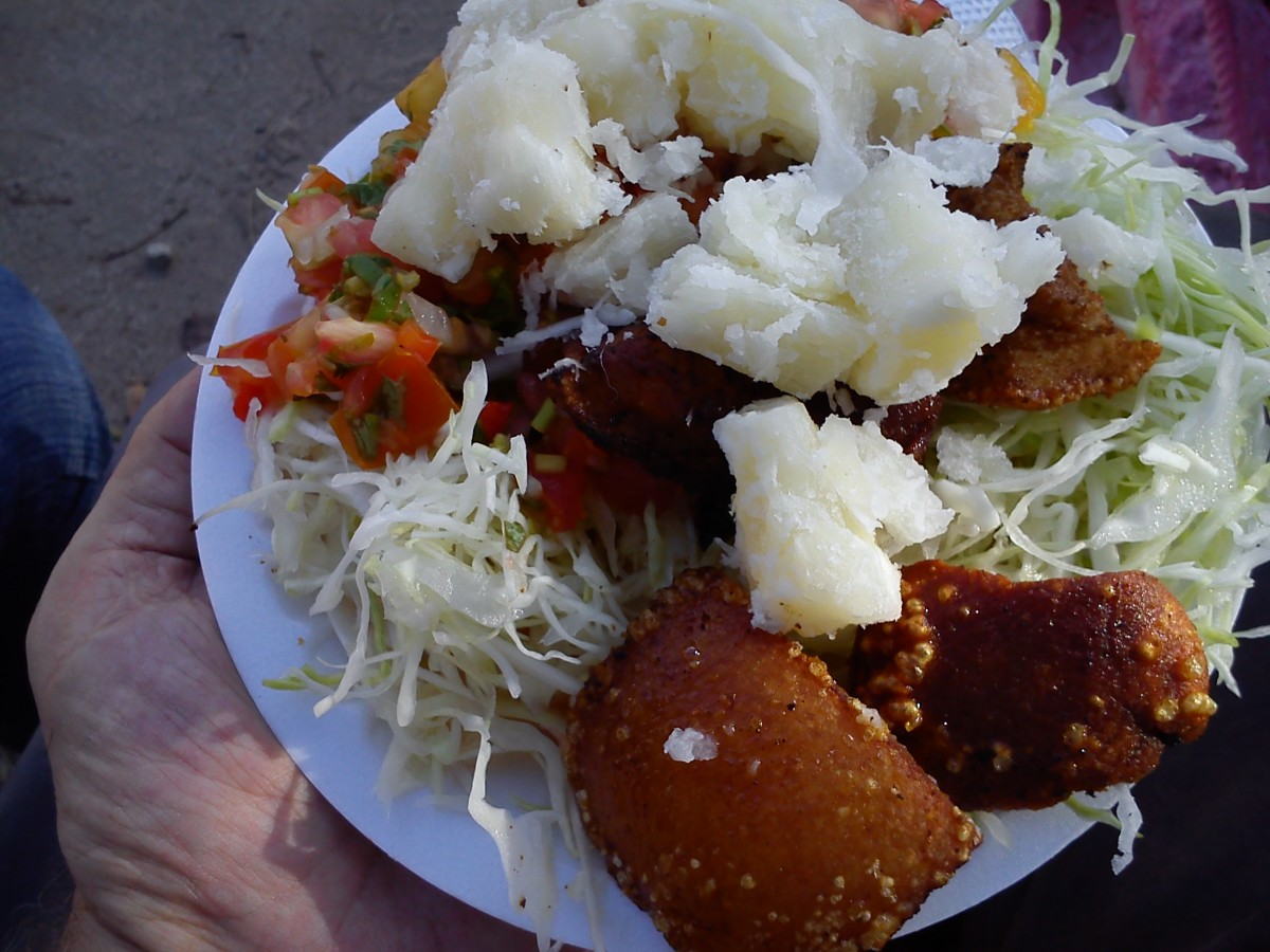 A plate of vigorón, pork skin fried in pig lard with boiled yucca root, shredded cabbage and chimichurri.