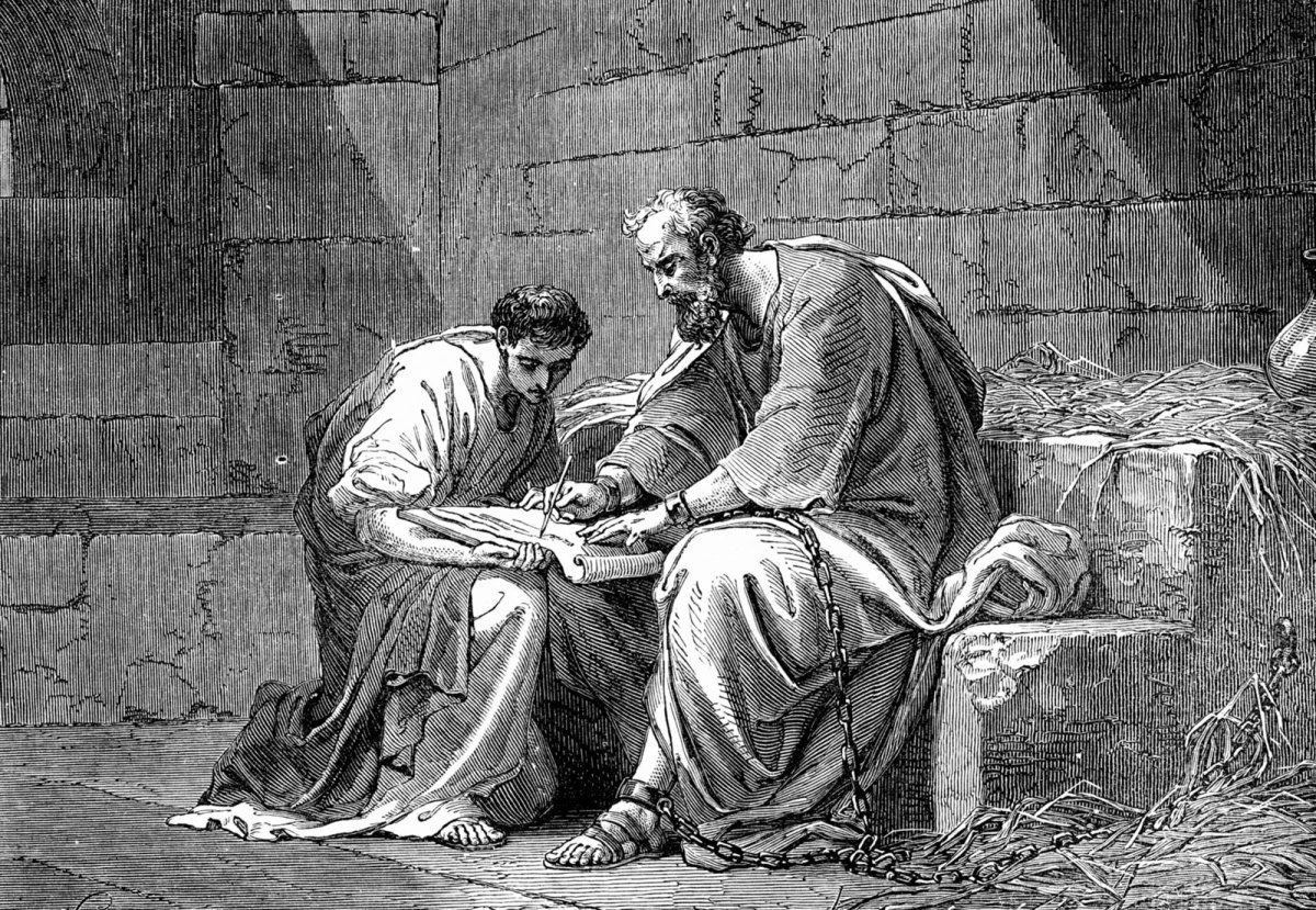 Paul dictates to Tertius his scribe while in chains.