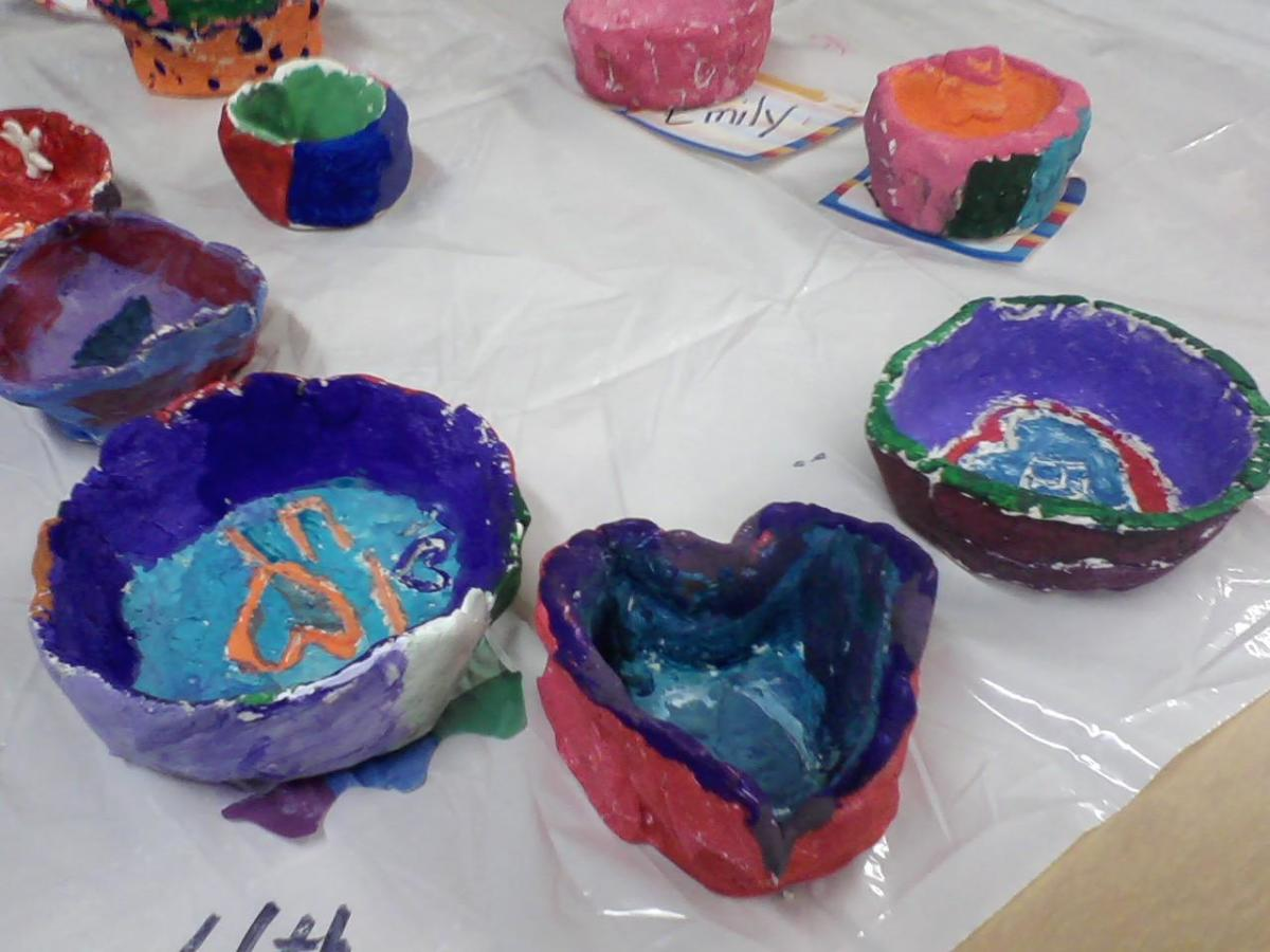 Painted and drying 4th grade pinch pots