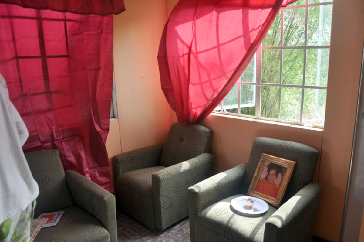 A comfortable sofa set along with the gifted picture of Baba which was requested by the grateful family.