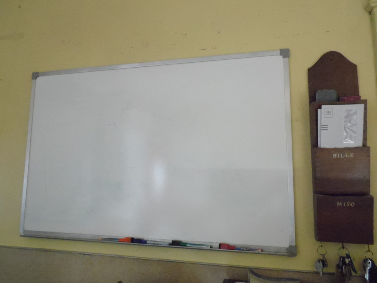 A large dry erase board helps keep everyone goig in the right direction.
