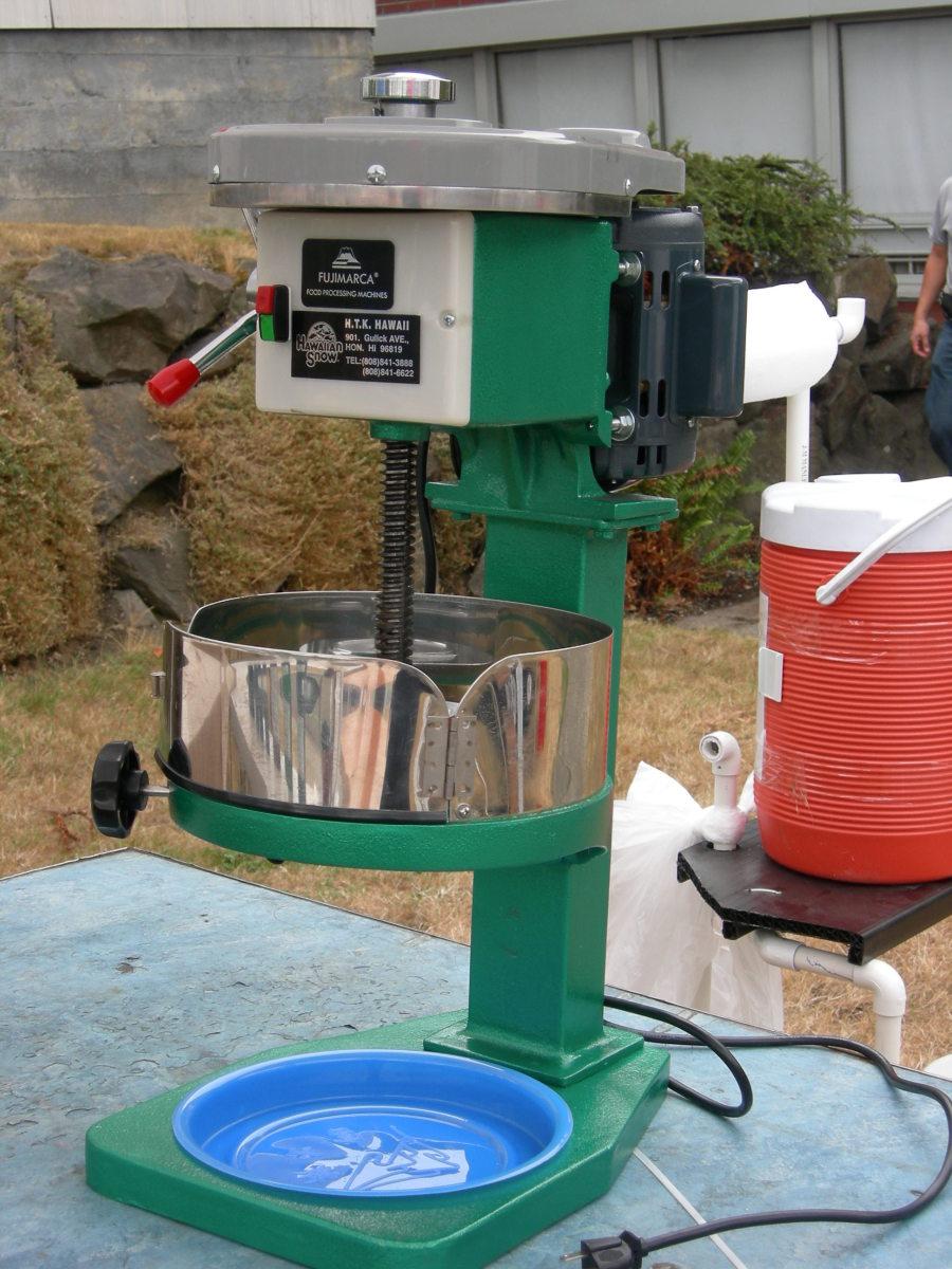 An electric powered ice shaving machine