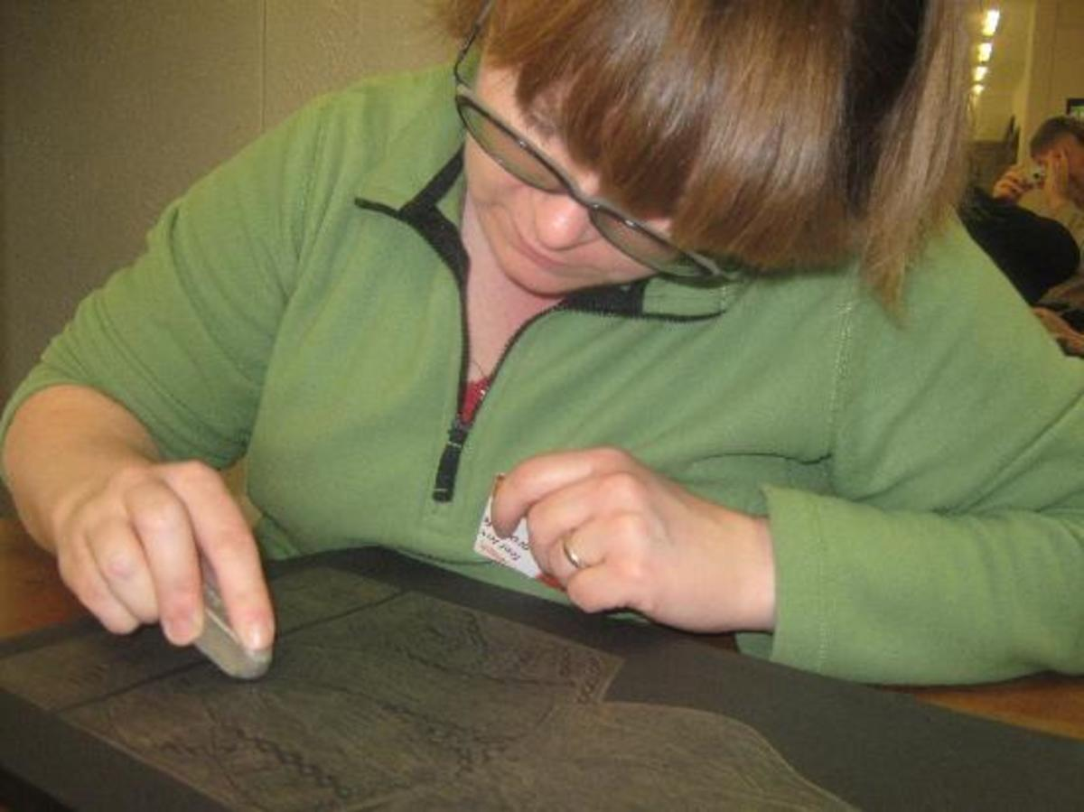 Individual completing an brass rubbing