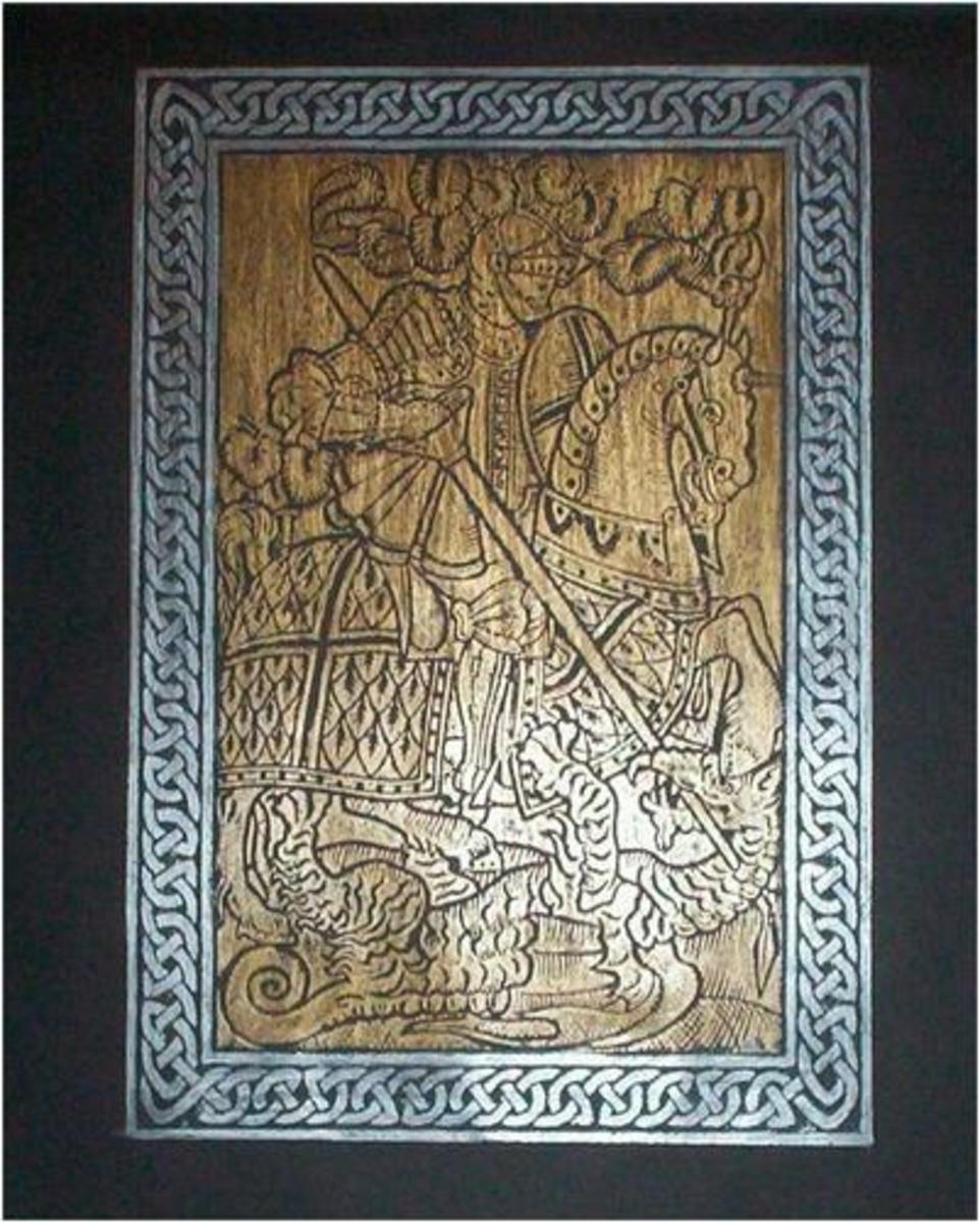 Brass rubbing of St. George and the Dragon using a bronze crayon for St. George and a silver crayon for the frame around the picture.