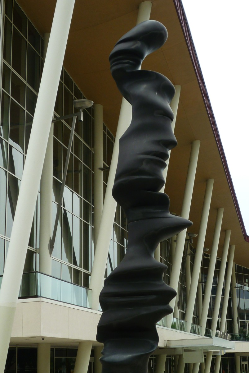 Closeup photo of the skinnier sculpture.  See the faces?