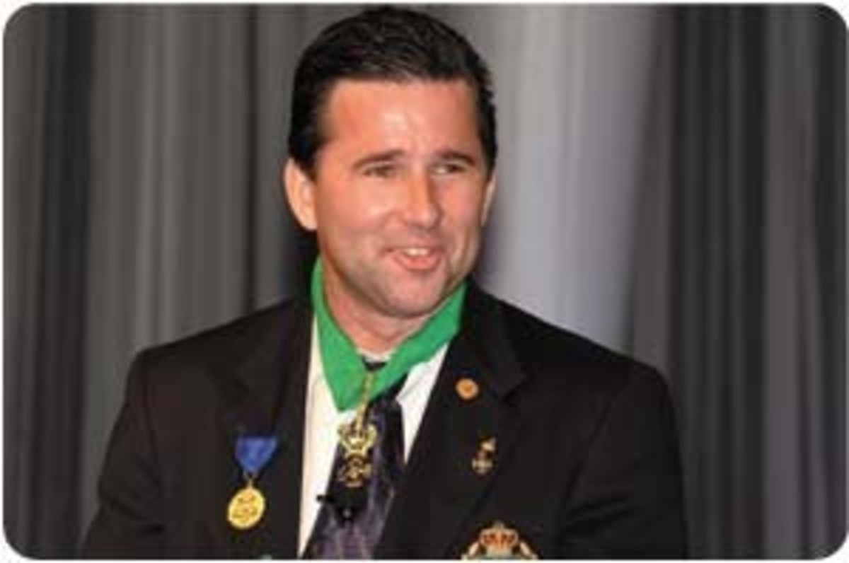 Darryl See, during his happier days when he got some sort of a medal, date unknown