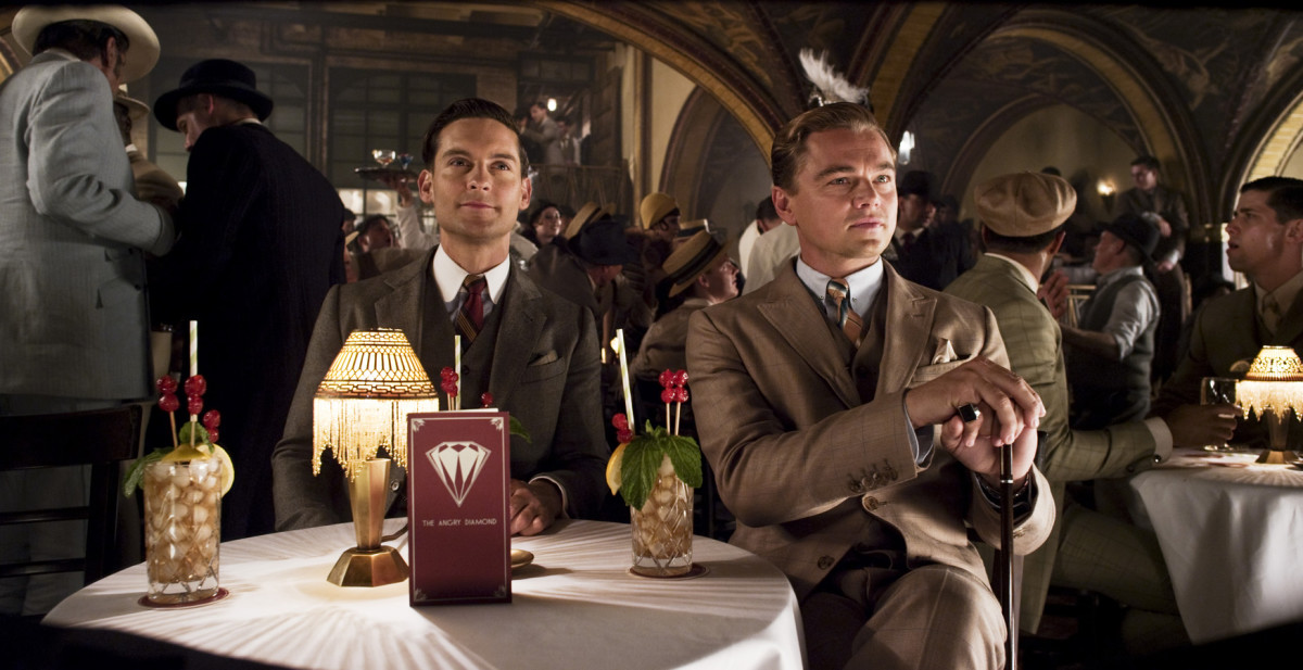 Tobey Maguire as Nick Carraway and Leonardo DiCaprio as Jay Gatsby.