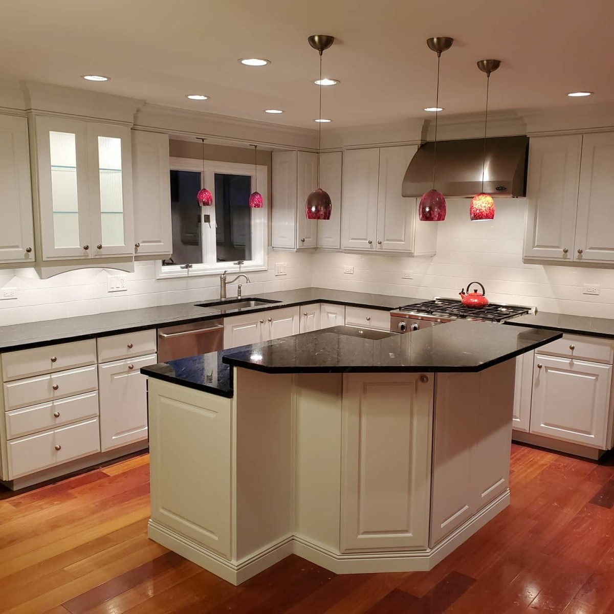 A kitchen I painted, including the walls, ceiling and cabinets.