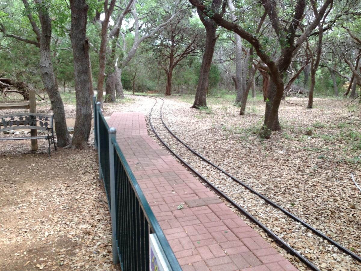 Train track through lovely tree shaded Oaks Williamson County Regional Park  Leander and Cedar Park TX