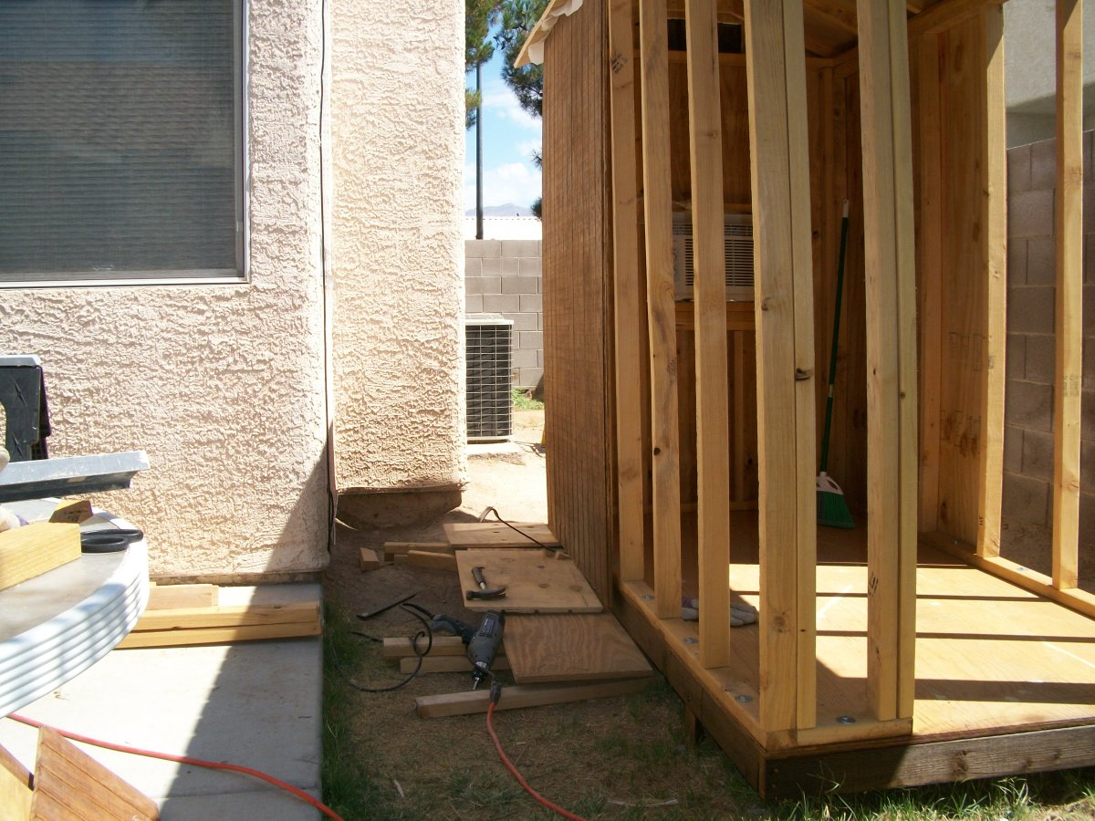 To install heavy T1-11 siding by yourself you have to prepare a little support structure from which a short pry bar can be stepped on to ease the piece into position