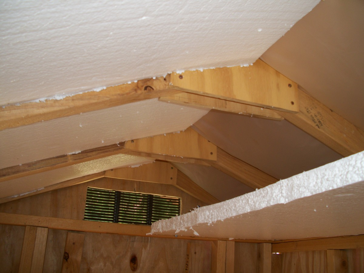 View of ceiling showing concept of double insulation.  Used scraps of insulation to seal off attic so air conditioner could be used while installing insulation in walls.