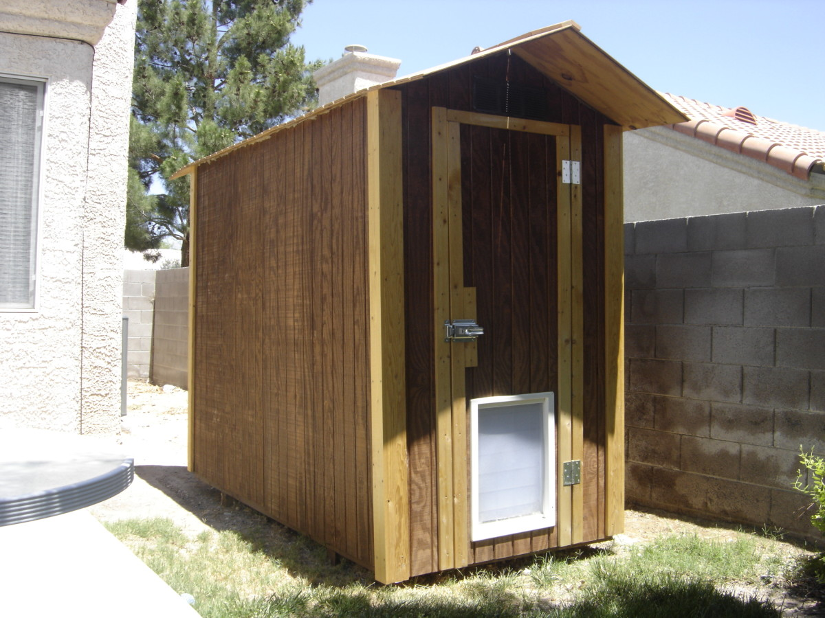 Finished shed/doghouse with air conditioner.