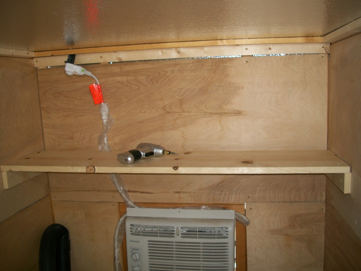 Shelf above air conditioner