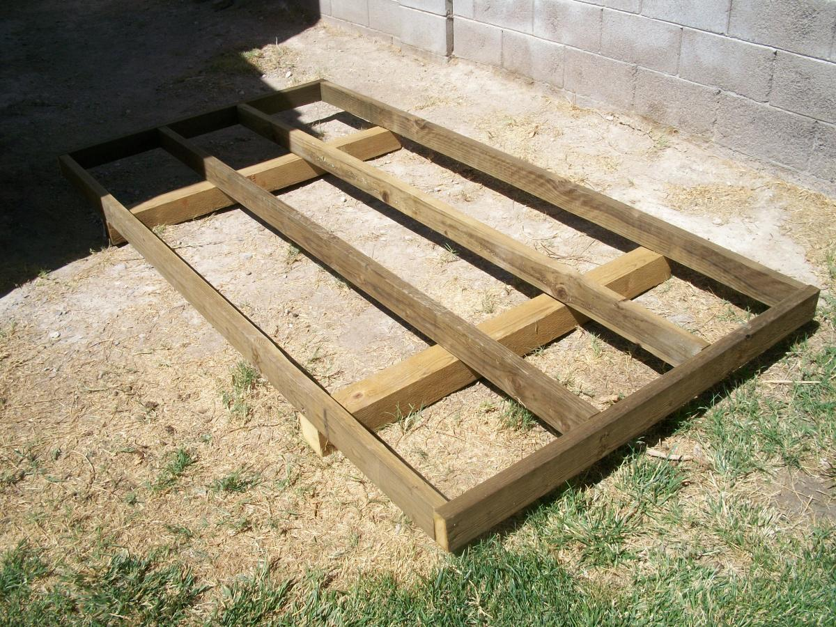 Floor joists and bands attached to 4x4 skids, all pressure treated lumber