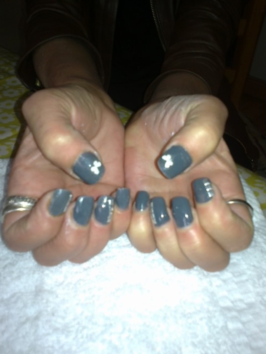 Full set of acrylic nails with full colour and nail art.