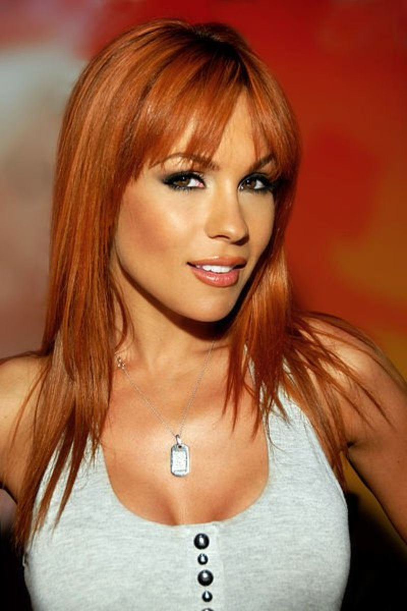 Bright red hair with tan skin