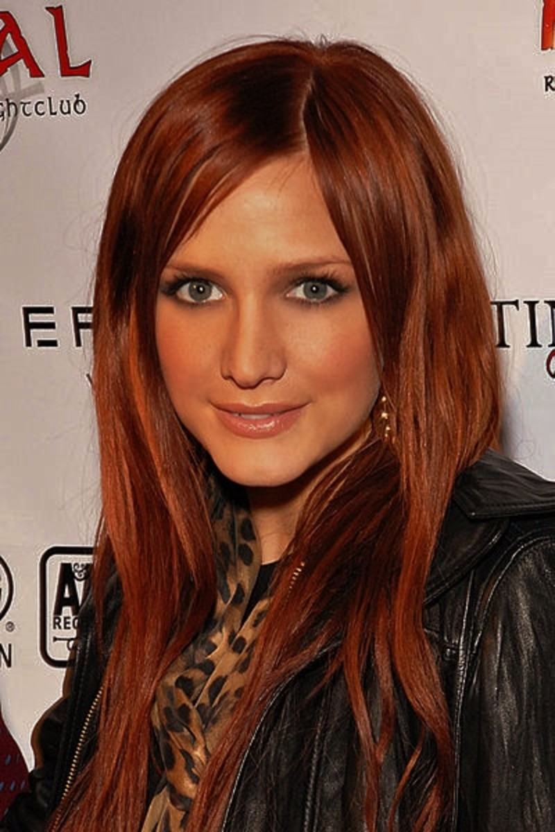 Ashlee Simpson with red hair and tan skin