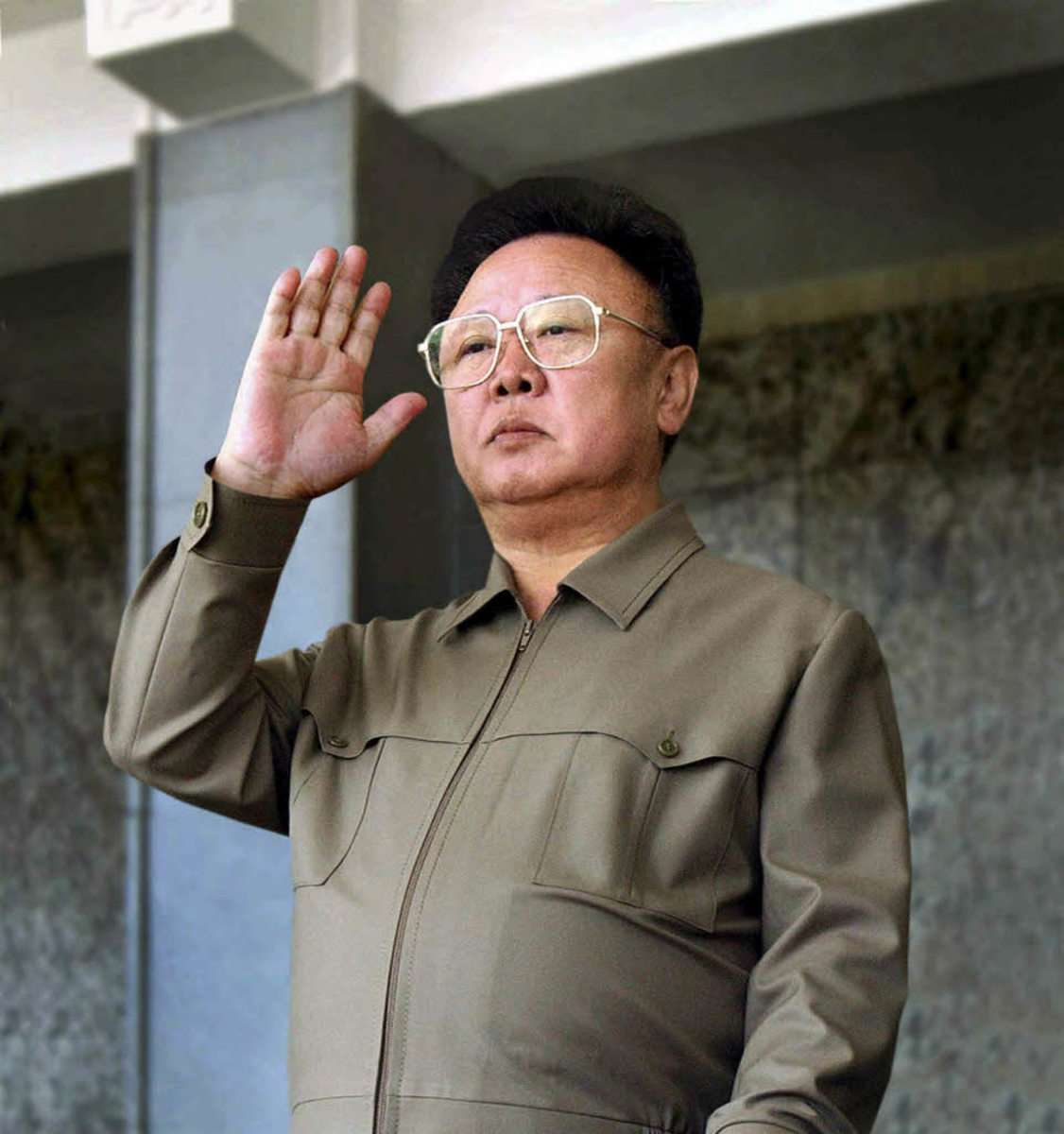 Kim Jong-il waving to the seething masses...not much change  over the years