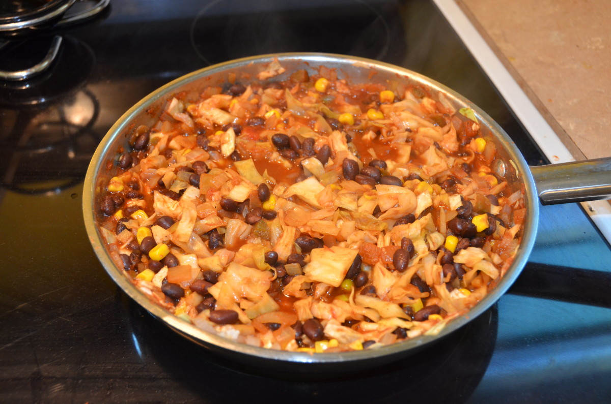 Cooked Spicy Vegetarian Chili with Cabbage and Black Beans in skillet.