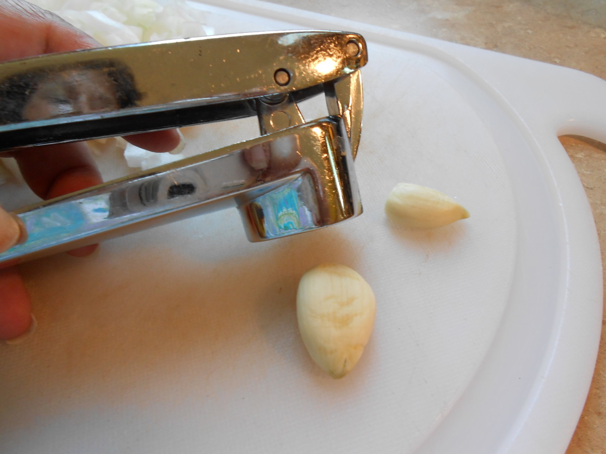 Get ready to put each clove into your garlic press.