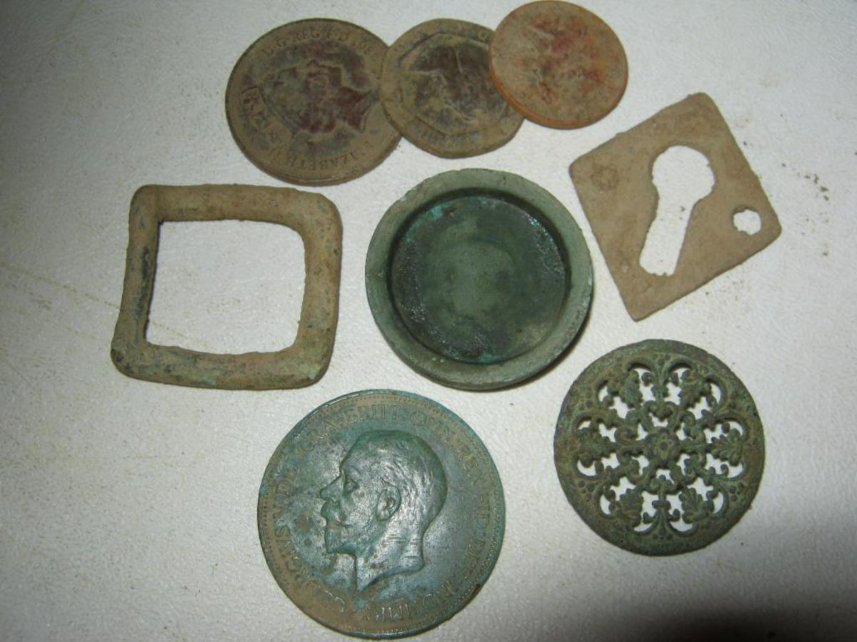 Soon you will be finding average objects like decimal coins, old copper  penny or two, a buckle and bits and pieces.