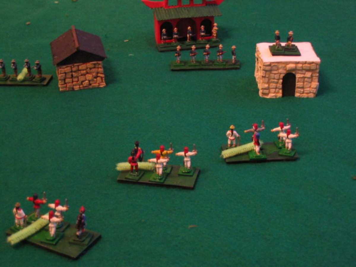 Typical battle scene using Tuan:  Boxer Rebellion Miniatures Rules.  Boxers are pressing American Marines.