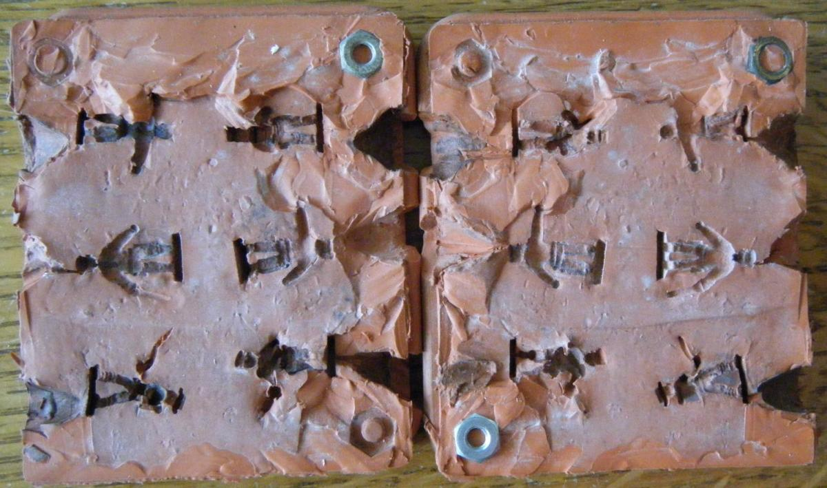 A typical silicon mold producing six infantry figures
