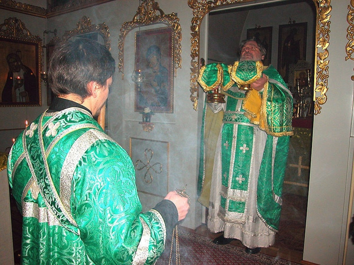 Orthodox priest censing at entrance