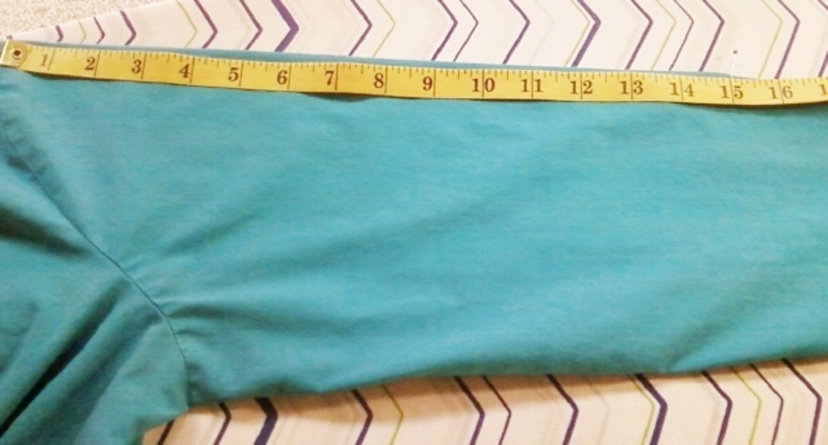 Measuring the top part of the sleeve to be cut.