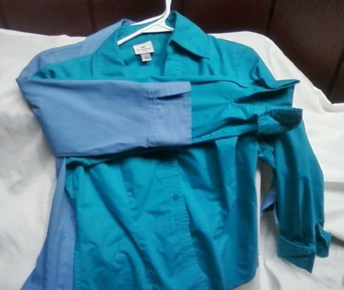 The two blouses, one with a full-length sleeve to be altered, and the model 3/4 sleeve.