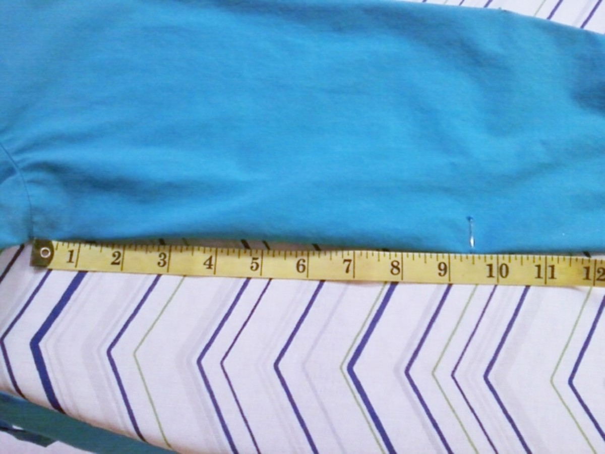 Measuring the underside of the sleeve to be cut.