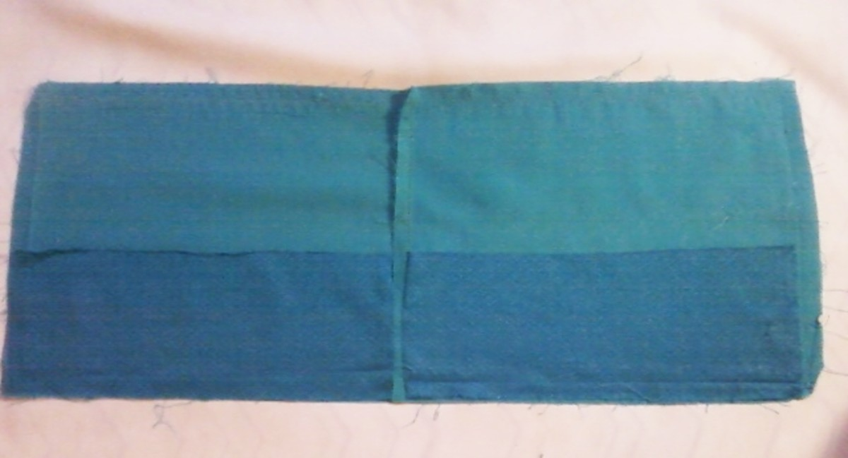 The interfacing covering the bottom section of the cuff.