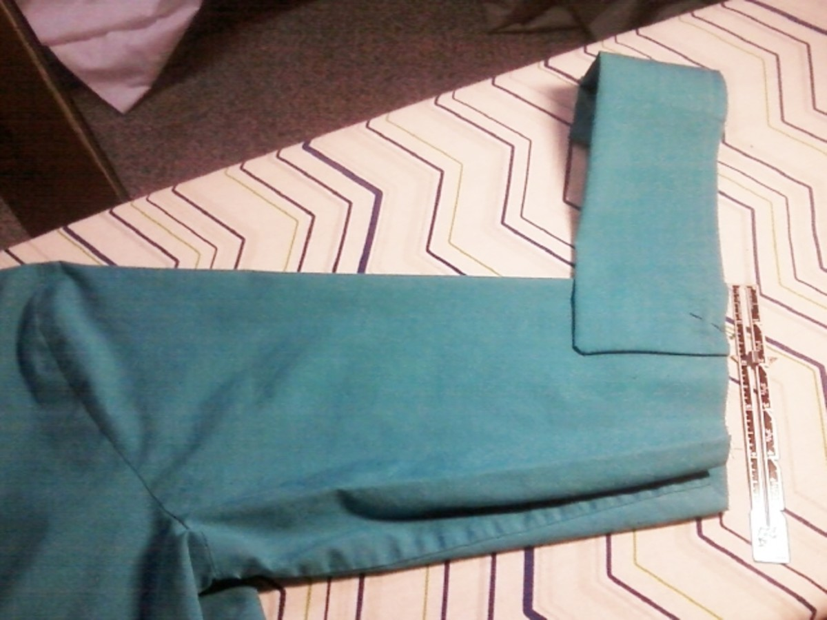 "Pinning the cuff  1 7/8"" below the shoulder seam axis. This view is the back side of the right arm."