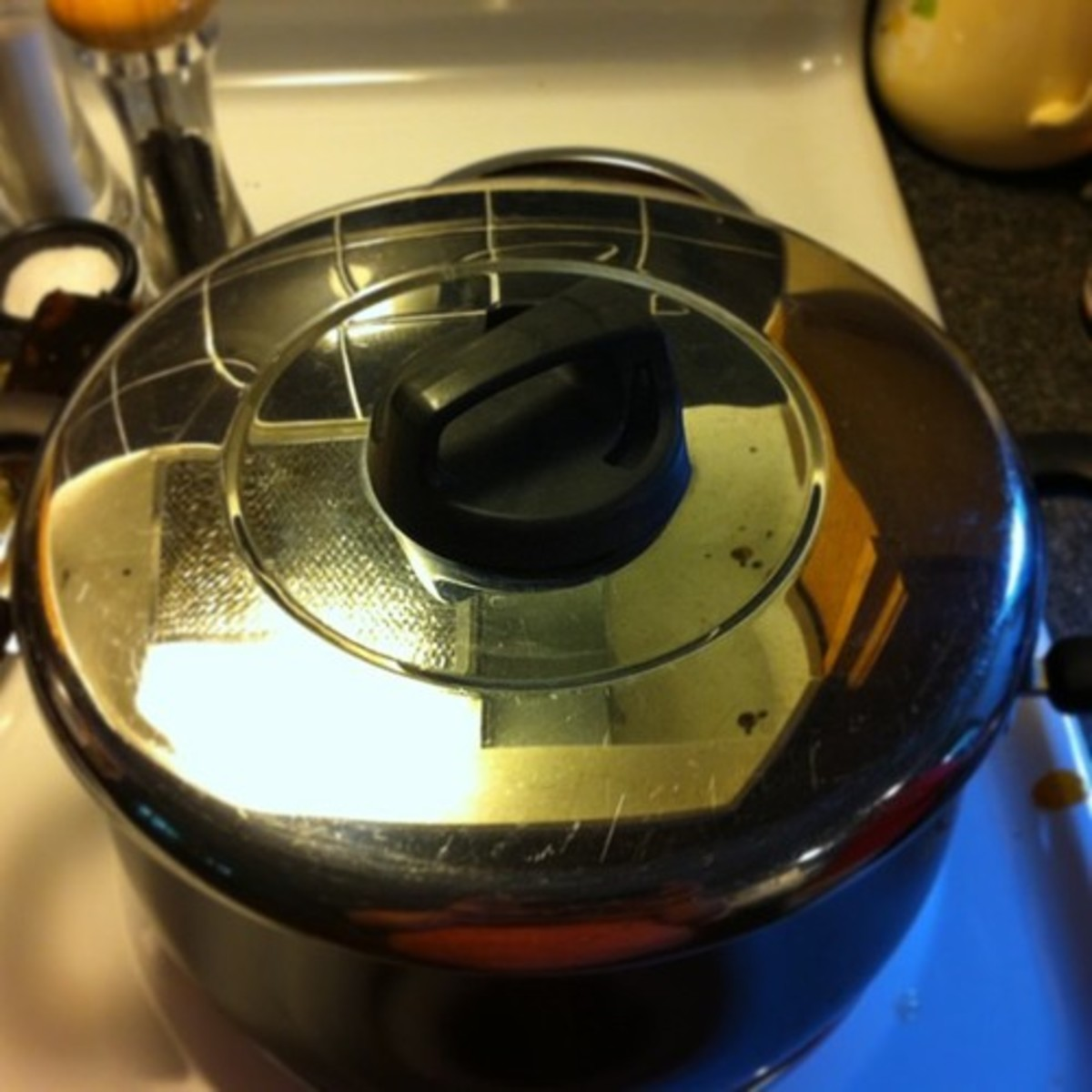 Make sure the lid seals well on your pot. Turning the temperature down will pull the lid on tighter and keep things cooking nicely. If your lid has a vent, close it.