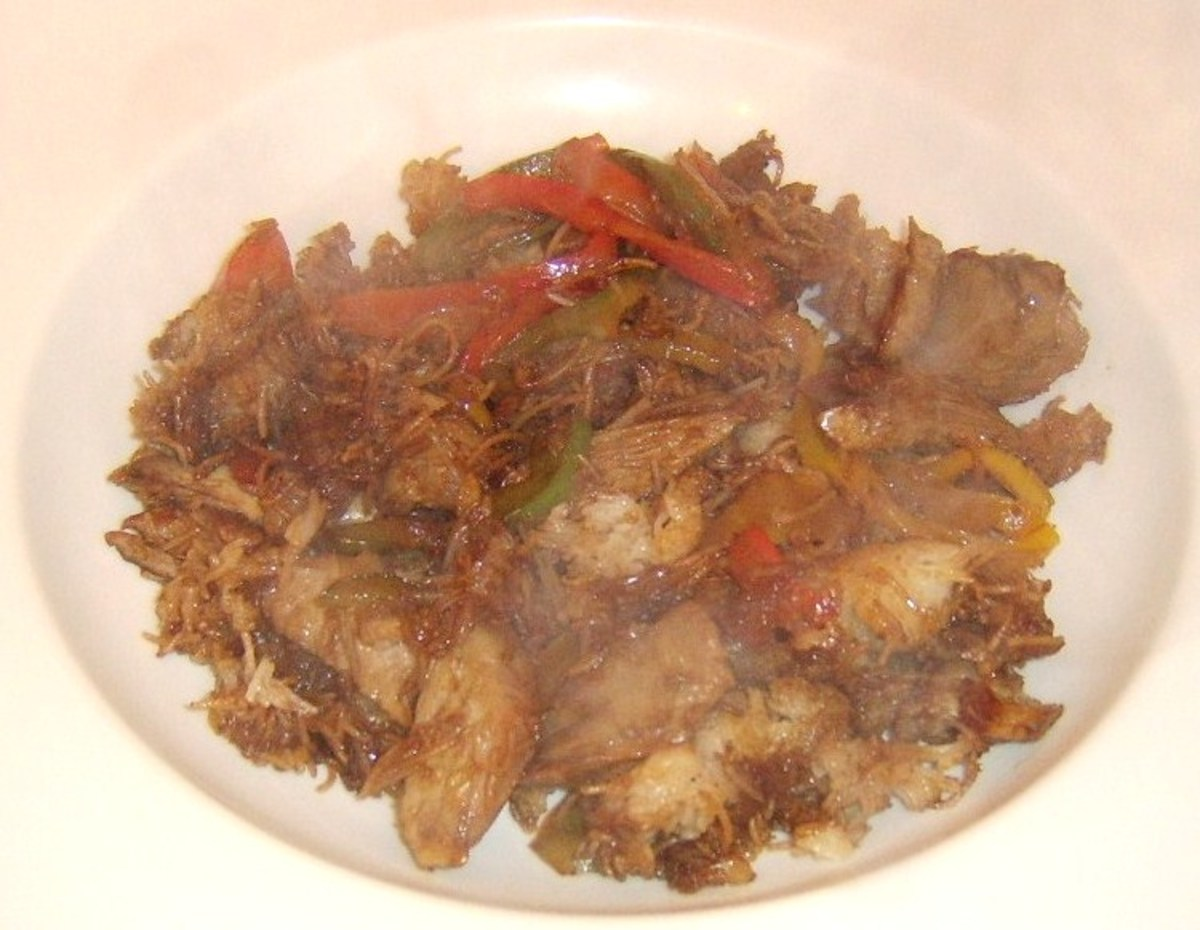 Turkey drumstick meat is stir fried with rice noodles, bell peppers and soy sauce