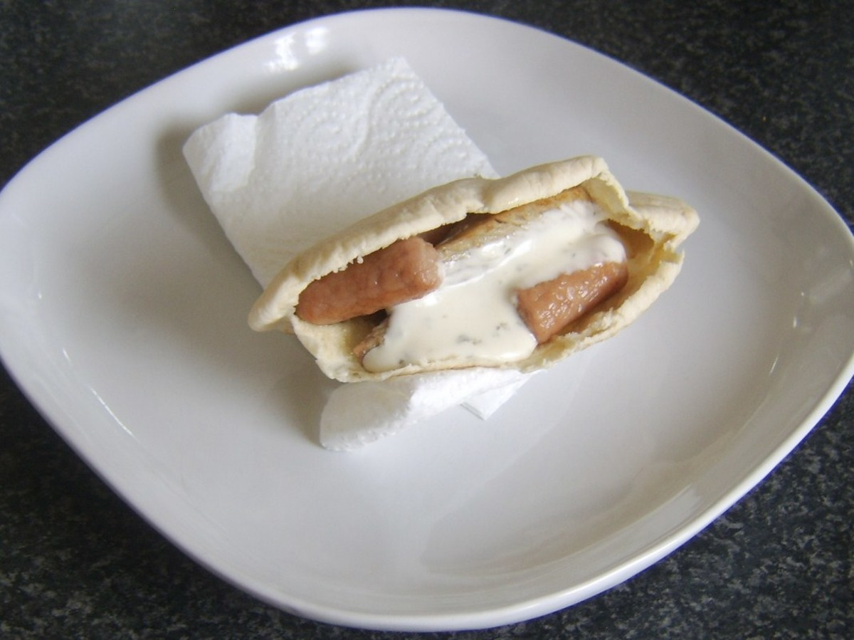 Refried turkey leg meat, mini sausages and ranch dressing are incorporated in a pitta bread sandwich