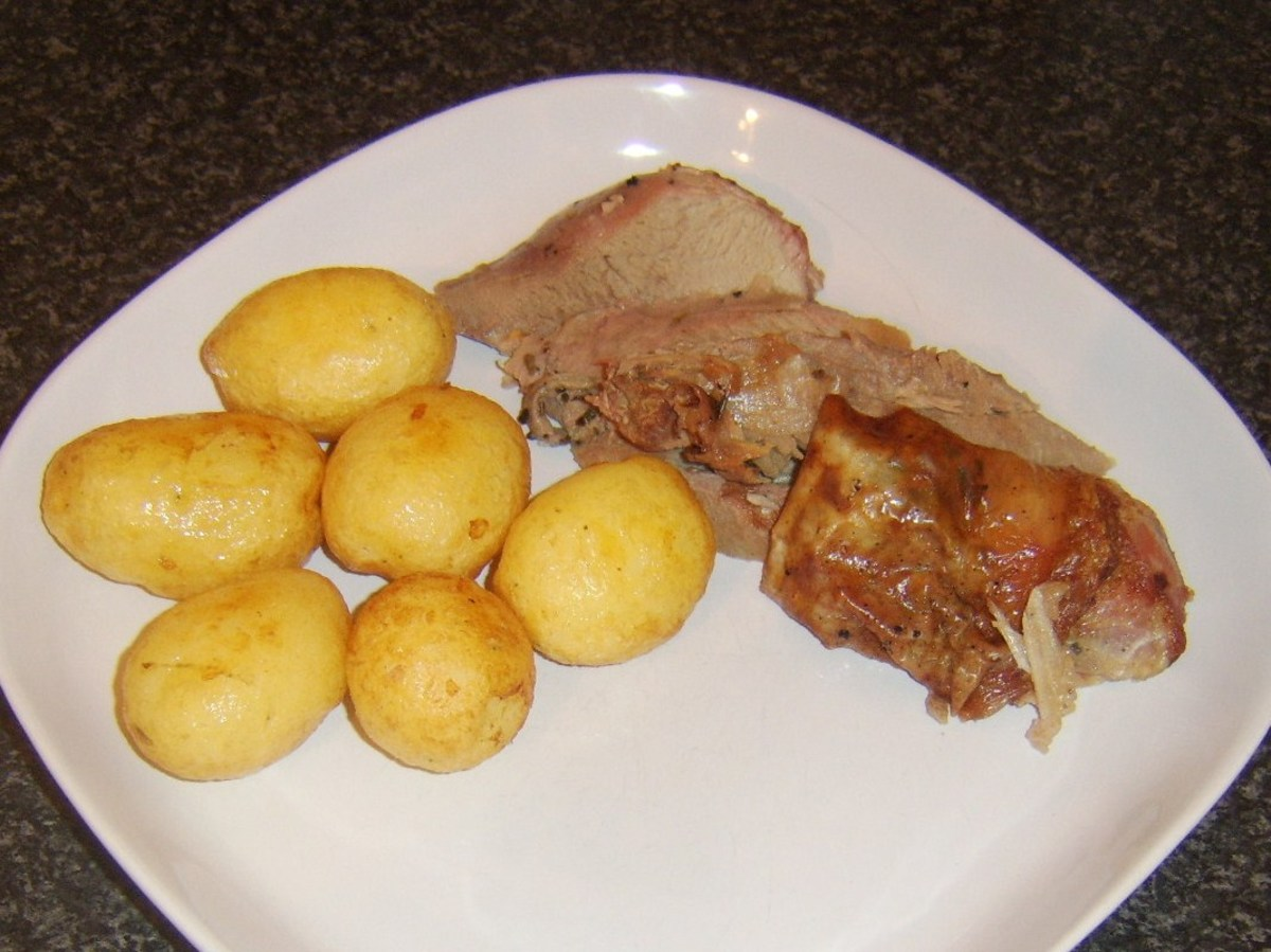 Turkey meat and potatoes are plated